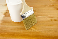 Wood texture, can and paintbrush. / housework Royalty Free Stock Image
