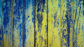 Wood texture. Closed up of old wood background. Vintage wood background with blue and yellow color peeling paint Royalty Free Stock Photos