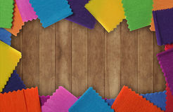 Wood texture with colorful paper Stock Photos