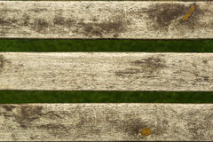 Wood texture on distant green grass Royalty Free Stock Photography