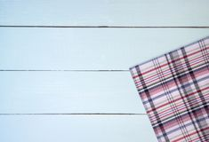 Wood texture. Empty white wooden table covered with checkered tablecloth Royalty Free Stock Image