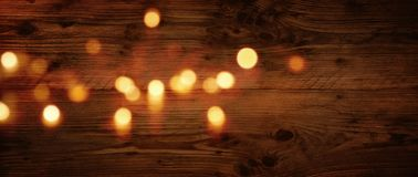 Wood texture with festive golden bokeh stock images