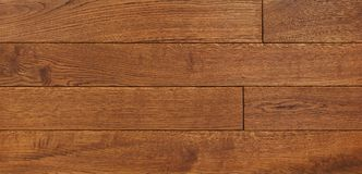Wood texture background for design, oak toned brown board . Royalty Free Stock Photo
