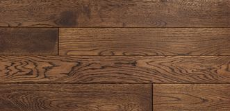 Wood texture background for design, oak toned brown board . Stock Photos