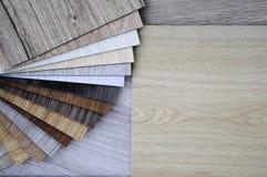 Wood texture floor Samples of laminate and vinyl floor tile on w Stock Image