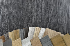 Wood texture floor. Samples of laminate and vinyl floor tile on wooden Background for new constuction or renovate building Stock Photos