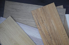 Wood texture floor Samples of laminate and vinyl veneer on woode. Samples of laminate and vinyl floor tile on wooden Background Stock Photography