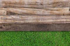 Wood texture on grass. Brown wood texture on green grass Royalty Free Stock Image