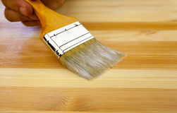 Wood texture, human hand and paintbrush. / housework background Stock Photography