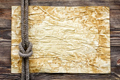 Wood texture with paper and marine knot. Closeup Royalty Free Stock Photos