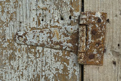 Wood texture with rusty iron hinge Royalty Free Stock Photos