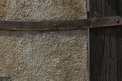 Wood texture with rusty iron hinge Stock Photos