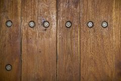 Wood texture with screws. Texture of dark wood planks with exposed screws Stock Image