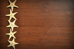 Wood texture. With starfish good for web backgrounds Stock Images