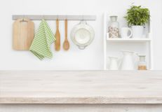 Wood texture table over blurry kitchen wall and shelf background.  royalty free stock image