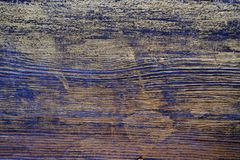 Wood texture treated with ebony stain and gold paint. Surface treatment of antique wood stock photo