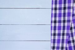 Wood texture. Background with copy space. White Wooden table covered with tablecloth cloth checkered plaid on top view Stock Image