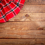 Wood texture, wooden table with red tablecloth tartan top view. Royalty Free Stock Photos