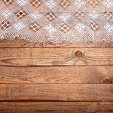 Wood texture, wooden table with white lace tablecloth top view. Stock Photo