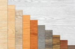 Wood Textured Descending Graph Bars. Wood textured graph bars in linear descending order over a white wood background Stock Photo