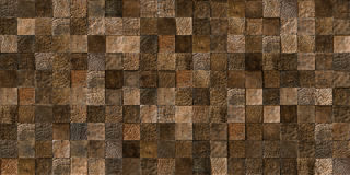 Wood tiles seamless texture. A seamless texture of log ends tiles, showing the natural grain of the wood. The decorative panel made from a natural material used Royalty Free Stock Images