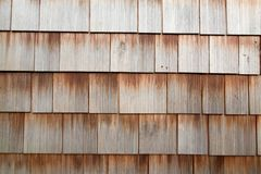 Wood Tiles on a Wall. This is a photo of wood tiles and siding that are on a wall Royalty Free Stock Photo