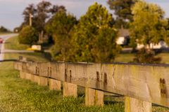 Timber Guardrail Along Highway - Paris Pike, Central Kentucky. A wood / timber guardrail lines the famed historic horse farms along Paris Pike between Lexington Royalty Free Stock Photo