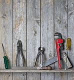 Wood Tools Background. A still-life of tools on a rustic wood shelf background Royalty Free Stock Photos