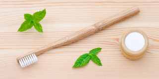 Wood toothbrush and xylitol, soda, powder, salt, mint on wooden Royalty Free Stock Photography
