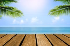 Wood top table sea and beach. Wood top table Abstract blur Landscape and blue sea waves.as background. Can be used for display or montage your products stock photo