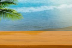 Wood top table sea and beach. Wood top table Abstract blur Landscape and blue sea waves.as background. Can be used for display or montage your products royalty free stock photo