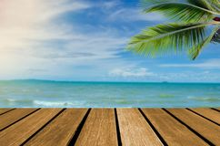 Wood top table sea and beach. Wood top table Abstract blur Landscape and blue sea waves.as background. Can be used for display or montage your products royalty free stock photos