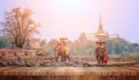 Wood top view on blurred Tourists on elephant ride tourism background. Tourism concepts royalty free stock image
