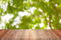 Wood top view empty. On bokeh circle green leaves and tree blurred background royalty free stock images