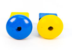 Wood Toy Beads. Toy wooden necklace beads or pieces on a white background royalty free stock photography