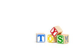 Wood Toy blocks. Toy blocks isolated on white spelling the word toys Stock Photos