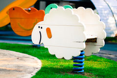 Wood toy lamb. In park royalty free stock photography