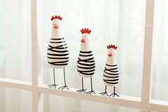 Wood toy sculpture Chicks Standing on the window Royalty Free Stock Photography