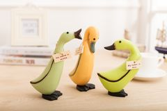 Wood toy sculpture ducks on the desk office Stock Images