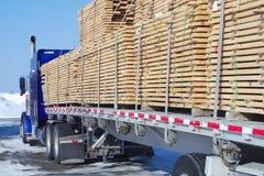 Wood transportation construction planks stack cargo Stock Photo