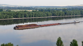 Wood transportation on Danube river,Slovakia, Royalty Free Stock Photo