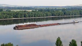 Wood transportation on Danube river,Slovakia, Royalty Free Stock Photo