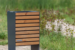 Wood trash bin in the park, close-up, save nature concept related. Trash bin in the park Stock Images