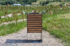 Wood trash bin in the park, save nature concept related Royalty Free Stock Images
