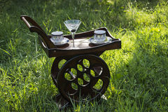 Wood Tray With Wheels And Coffee Cups and Martini Glass In the Nature Stock Photos