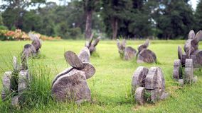 The wood is trimmed to the desired shape. Rabbit are made of wood on grass. stock photos