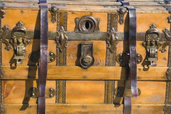 Wood trunk. Closeup of antique wood trunk showing hardware and straps Royalty Free Stock Images