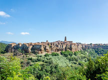 Wood and tuff walls under the medieval village of Pitigliano Stock Photography