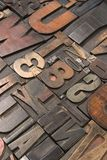 Wood type 5. An assortment of old wooden and metal type blocks Stock Photos