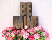Wood type be mine and little roses Stock Photography